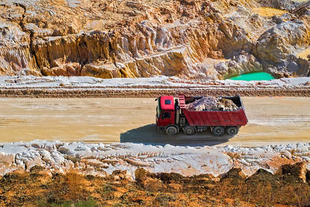 Red dump truck in a quarry