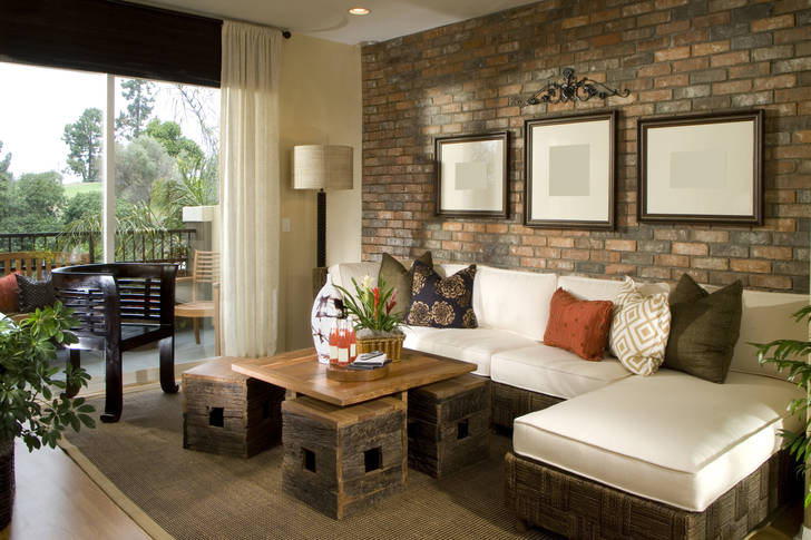 Living room with brick wall