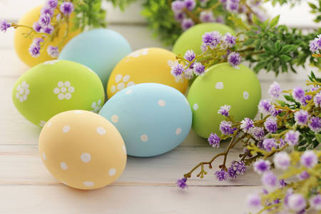 Easter eggs on a table with flowers