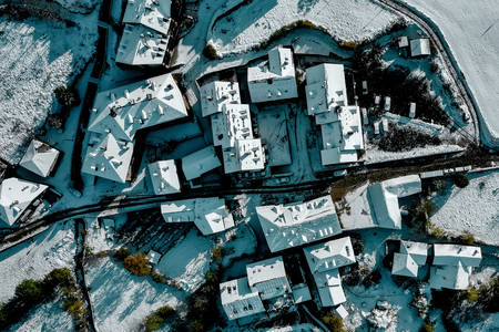 Snow covered roofs of houses