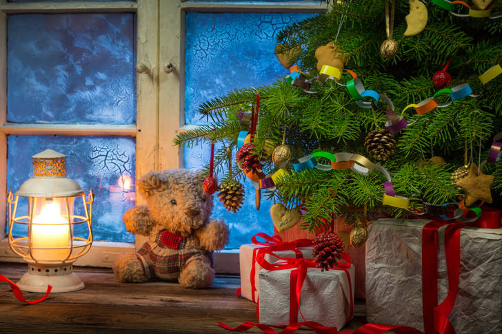 Christmas tree by the frosty window