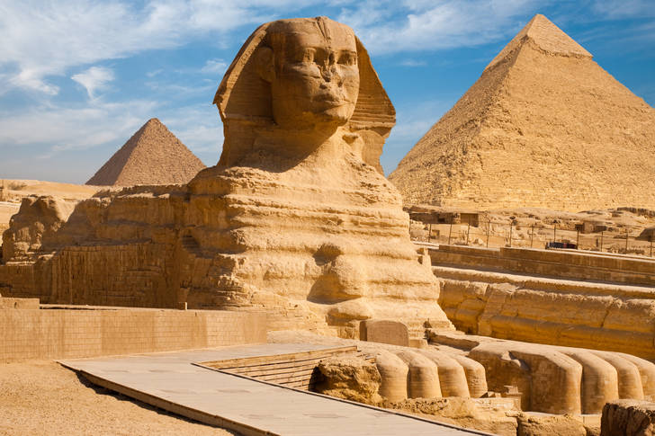 Great Sphinx on the background of the pyramids