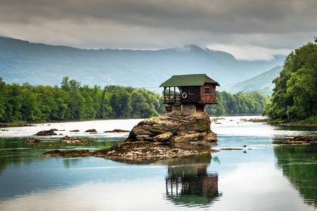 House on a stone on the Drina river