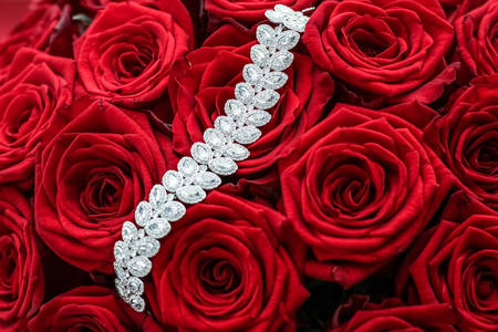 Luxurious bracelet on red roses