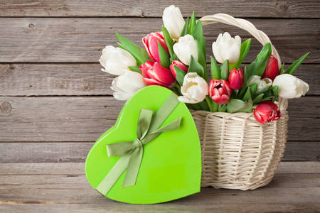 Tulips in a basket and a gift