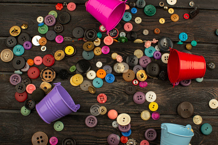 Buttons on a wooden table