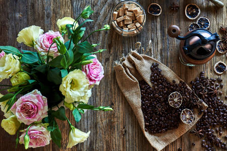 Coffee beans on a table with flowers