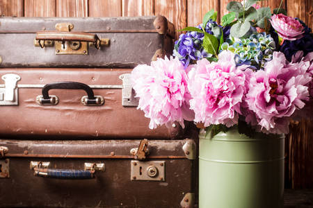 Bouquet of peonies and vintage suitcases