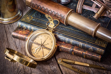 Compass, spyglass and old books