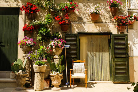 Facade of an old house with flowers