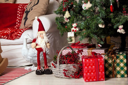 Dwarf with gifts under the tree