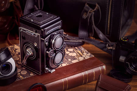 Old camera on a vintage book