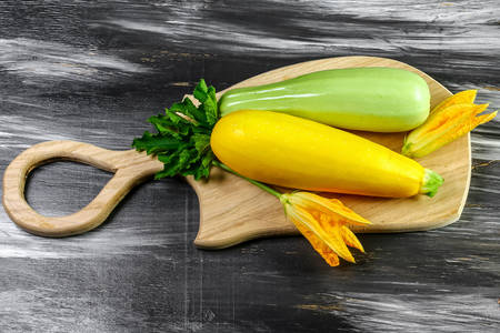 Zucchini on a wooden board