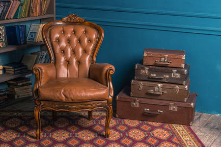 Antique armchair and suitcases