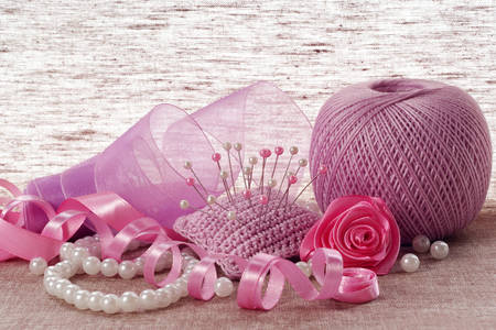 Pink satin ribbon, pins and pearls