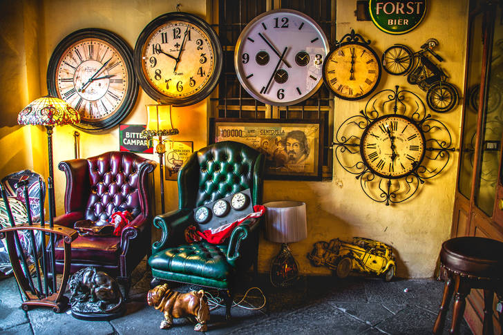 Vintage furniture and wall clock in an antique shop