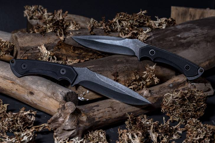Military knives on logs
