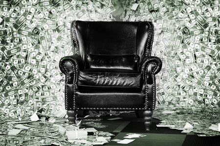 Leather armchair on the background of dollars