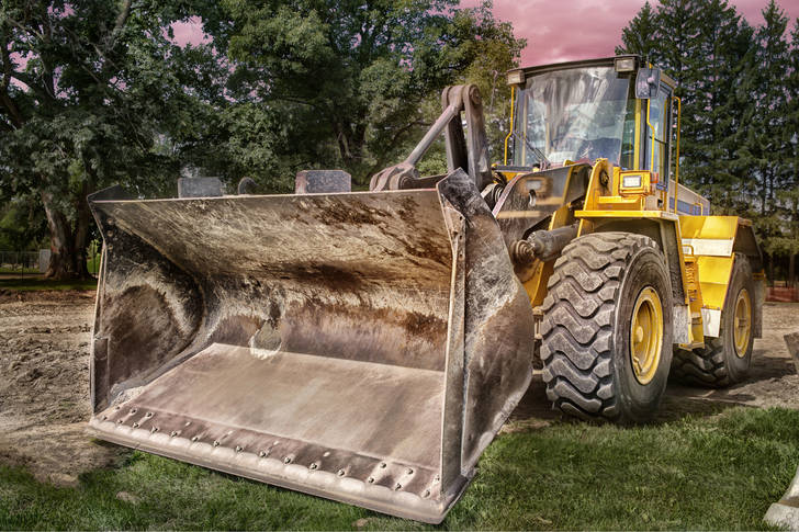 Tractor with bulldozer equipment