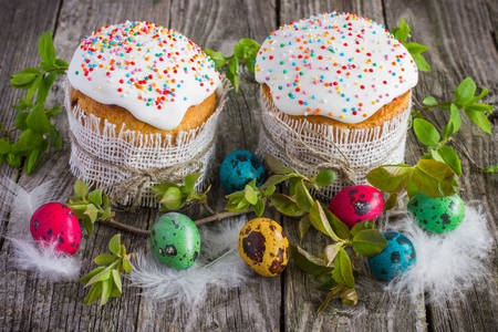 Easter eggs and cakes on a wooden table