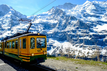 Yellow train in the mountains of Switzerland