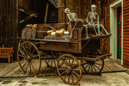 Old wagon with two skeletons
