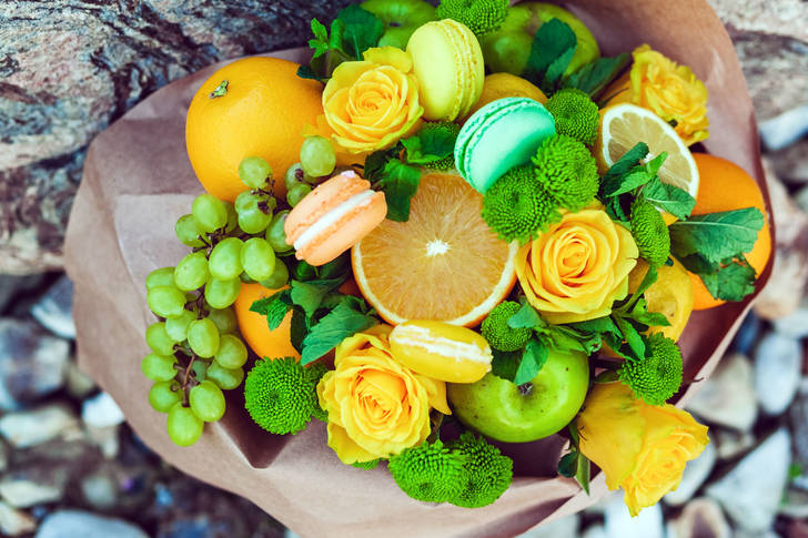 Bouquet of fruits, flowers and macarons