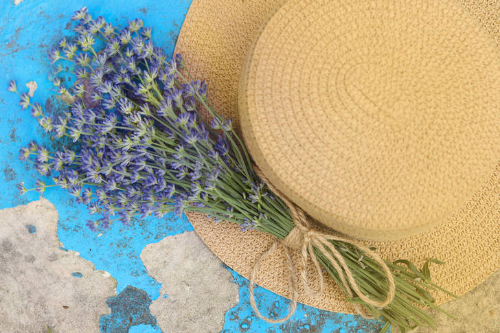 Lavender bouquet and straw hat