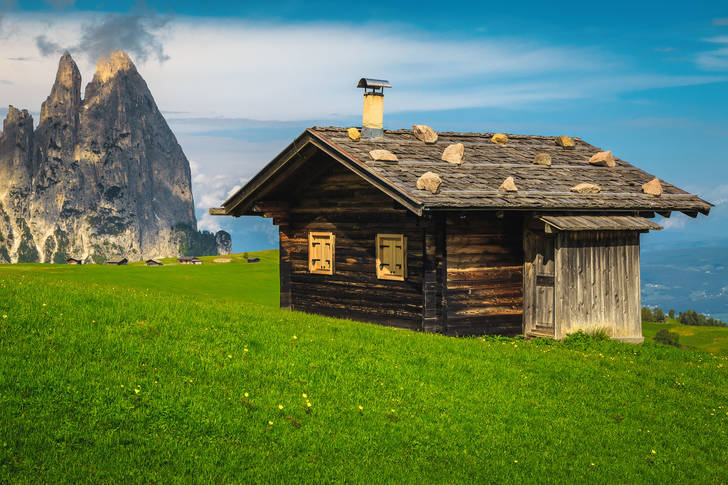 Wooden hut against the backdrop of Mount Schlern